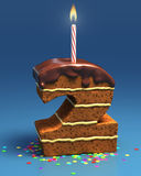 Number two shaped birthday cake with candle Royalty Free Stock Photography