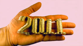 Number two thousand and eleven laid piles of coins Stock Images