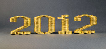 Number two thousand twelfth laid stacks of coins. Clouse up Royalty Free Stock Photo