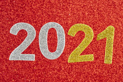 Number two thousand and twenty one over a red background. Annive Royalty Free Stock Photography