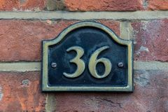 Number 36 in a village location. stock image