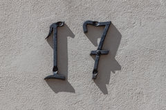 Number 17 on the wall Royalty Free Stock Image