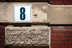 Number 8 on a wall Stock Image