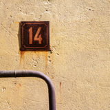 Number 14 on a wall Stock Images