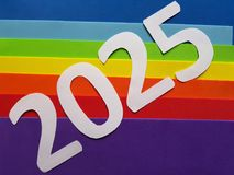 Number 2025 in white with foamy in rainbow colors background. Backdrop for ads related with multicolors, new year celebration, creative design, diversity and stock images