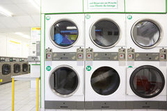 Number of white and gray washing machines Stock Image