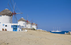 A number of windmills on Mykonos and ship at sea Stock Photos