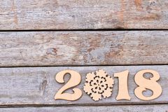 Number 2018 from wood and snowflake. Royalty Free Stock Photo