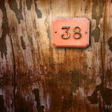 Number 38 on wooden background Royalty Free Stock Image
