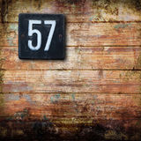 Number 57 on wooden background Royalty Free Stock Photos