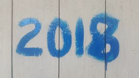the number 2018 on wooden boards written in blue paint Stock Photography
