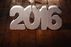 Number 2016 on wooden table background Royalty Free Stock Images