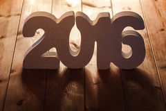 Number 2016 on wooden table background, new year template Royalty Free Stock Image