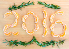 2016 number written with oranges sections on wooden background Royalty Free Stock Photography