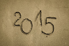 Number 2015 written into sand Stock Photography