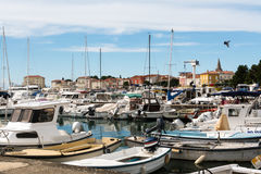 A number of yachts and sailing boats in the harbor. stock images
