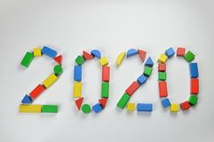 Number of the year 2020 with colorful toy wooden blocks