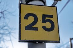 The Number 25. In a yellow background stock image