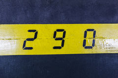 290 number on yellow stripe and black background Royalty Free Stock Image