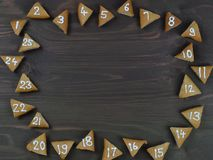 25 numbered advent cookies on brown wood Stock Photos