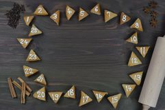 25 numbered advent cookies on brown wood Royalty Free Stock Image