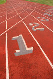 Numbered Athletic Tracks. Focus on being Number 1 - Numbered Lanes on Athletic Track Royalty Free Stock Photo