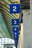 Numbered Bays at Bus Station. Numbered bays at a bus station stretching out into the distance Royalty Free Stock Photos