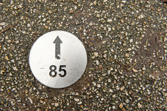 Numbered direction plate in pavement Royalty Free Stock Photos