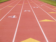 Numbered lanes running track Stock Photo