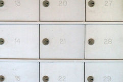 Numbered locked metal mailboxes Stock Photo