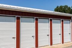 Numbered self storage and mini storage garage units. Numbered red self storage and mini storage garage units stock images