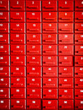 Numbered red wooden cases Stock Photos