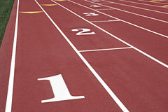 Numbered running lanes on a track Royalty Free Stock Photos