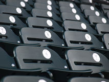 Numbered seats. View of a baseball park before the crowd arrives Stock Photos