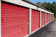 Numbered red self storage and mini storage garage units stock photo