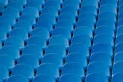 Numbered stadium seats. View of multiple partial rows of blue numbered stadium seats stock image