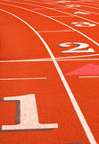 Numbered synthetic running track Royalty Free Stock Photos