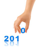Numbers 2010 and hand Stock Photo