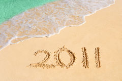 Numbers 2011 on beach. Concept holiday background Royalty Free Stock Images