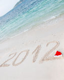 Numbers 2012 on tropical beach sand Royalty Free Stock Photography