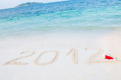 Numbers 2012 on tropical beach sand Stock Image