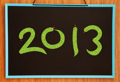 Numbers 2013. On chalkboard background royalty free illustration