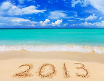 Numbers 2013 on beach. Concept holiday background stock photo