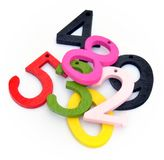Numbers. Of various colors over each other, surrounded by white background Royalty Free Stock Image