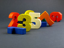 Numbers. A colored row of numbers shaped wooden toys royalty free stock images