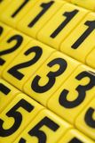 Numbers. Closeup of yellow numbers for children learning game - shallow DOF Royalty Free Stock Photos