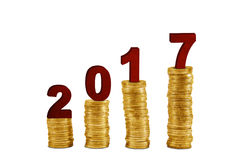 Numbers 2017 above piles coins Royalty Free Stock Photo