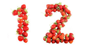 Numbers alphabet of red ripe strawberries. Stock Images