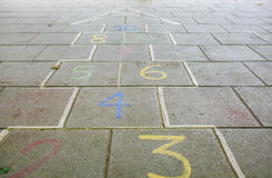 Numbers in the asphalt for children game Stock Image