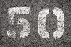 Numbers on Asphalt. Fifty numbers painted on asphalt Royalty Free Stock Photos